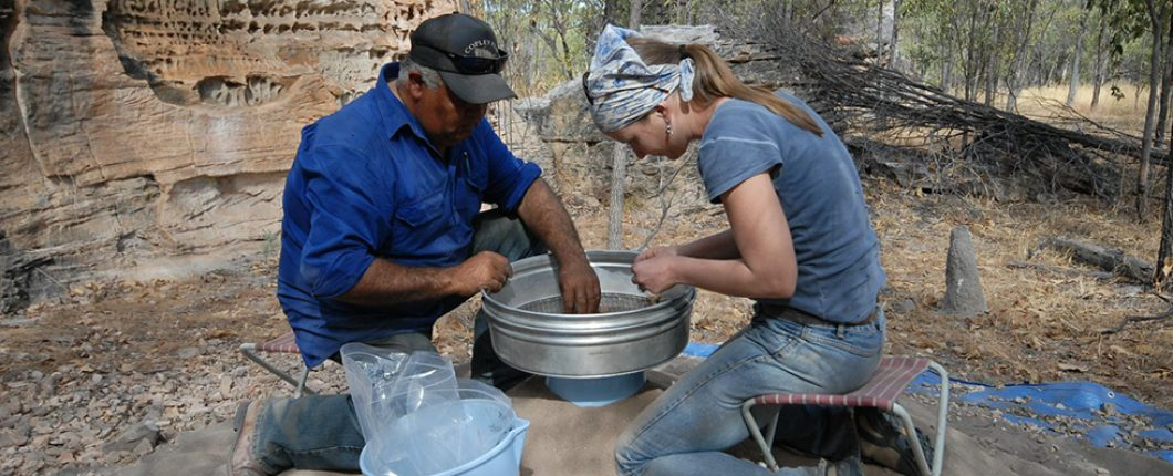 Mick and Kylie sorting artefacts from the sieves